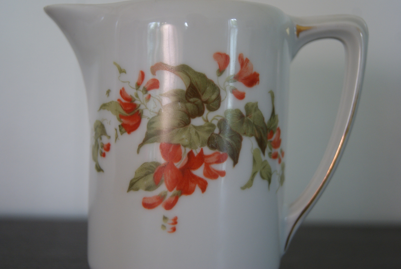 Porsgrund Olaf milk jug with red flowers and leaves