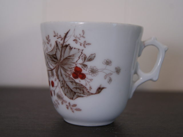 Porsgrund coffee cup with bird on rowan. Leaves, flowers and red fruits