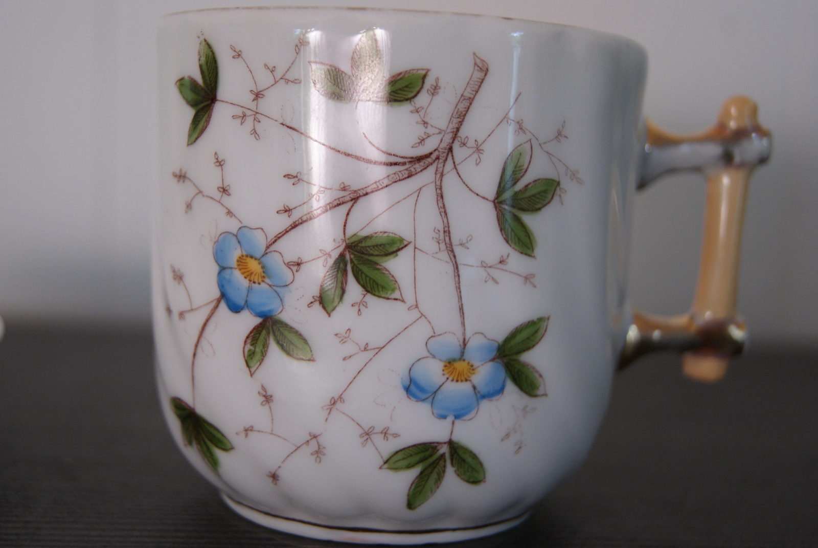 Porsgrund coffee cup with blue flowers, leaves and with handle like a stick