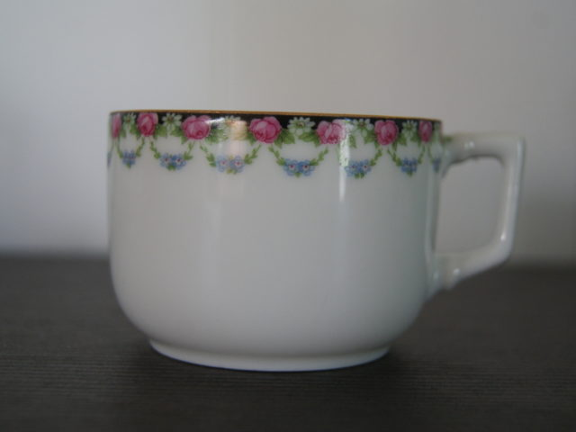 Porsgrund coffee cup flowers on black band with leaves and garlands