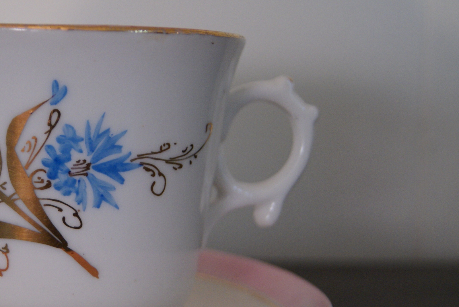 Waldenburg - Altwasser tea cup with saucer decorated with blue flowers, golden leaves and pink rim