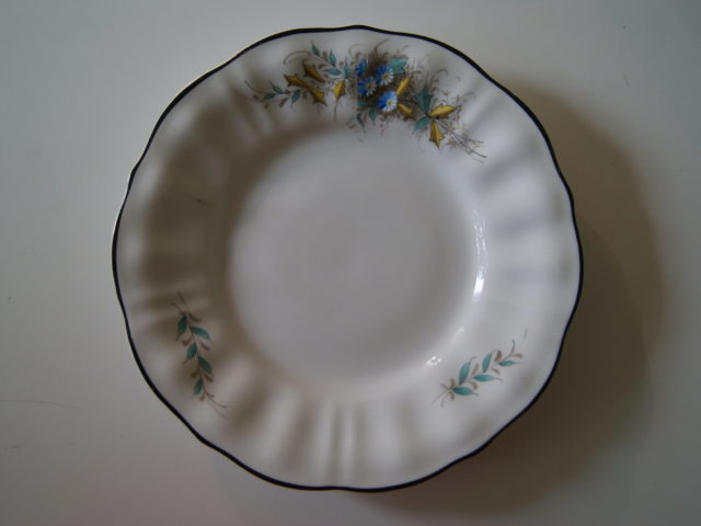 Waldenburg dish with blue and white flowers, leaves and black rim