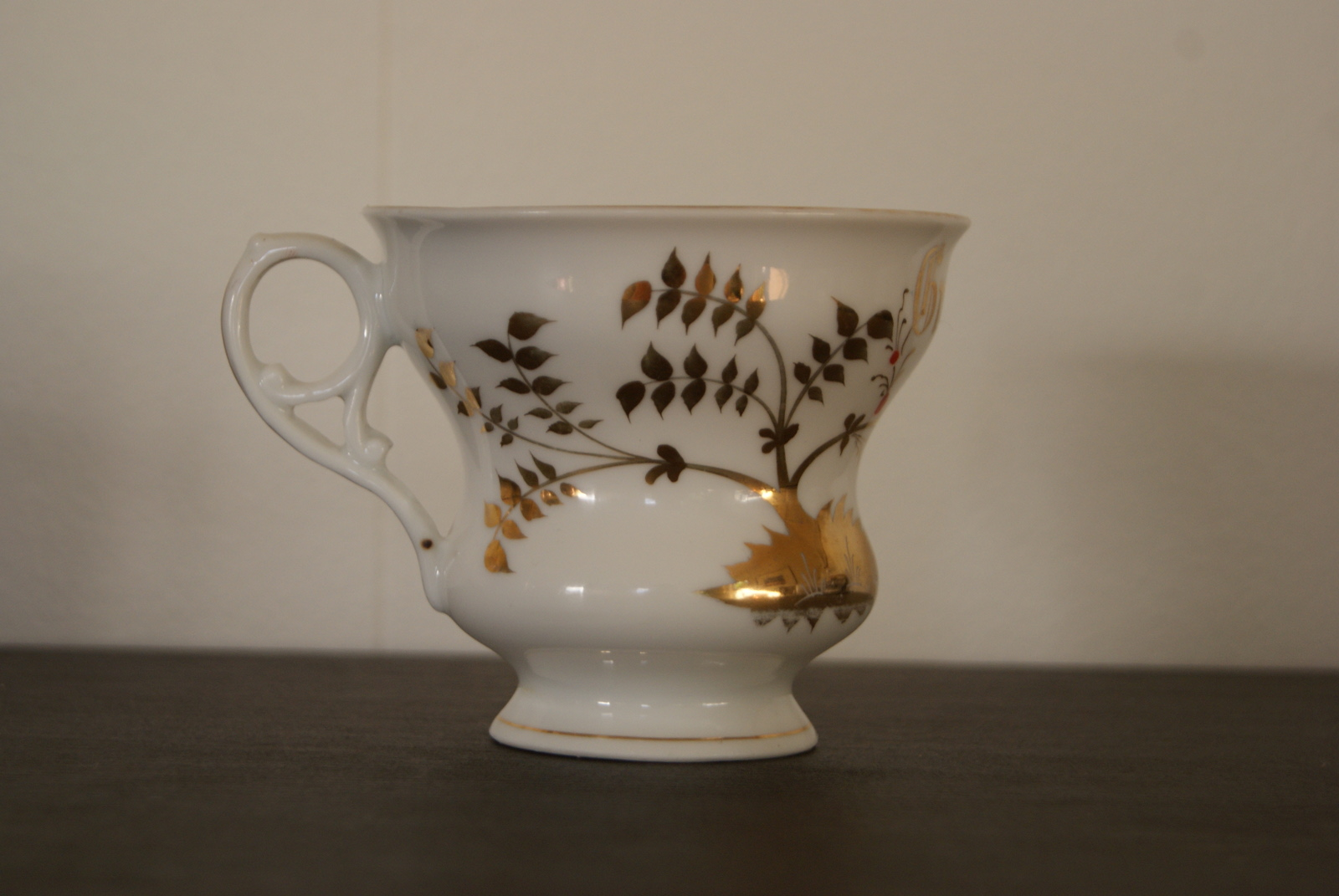 "Porsgrund cup with golden decor small flowers and ""Gratulerer"" inscription"