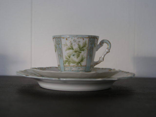 Niedersaltzbrunn Hermann Ohme cup with saucer and plate, handpainted green flowers and leaves, blue color with golden decor
