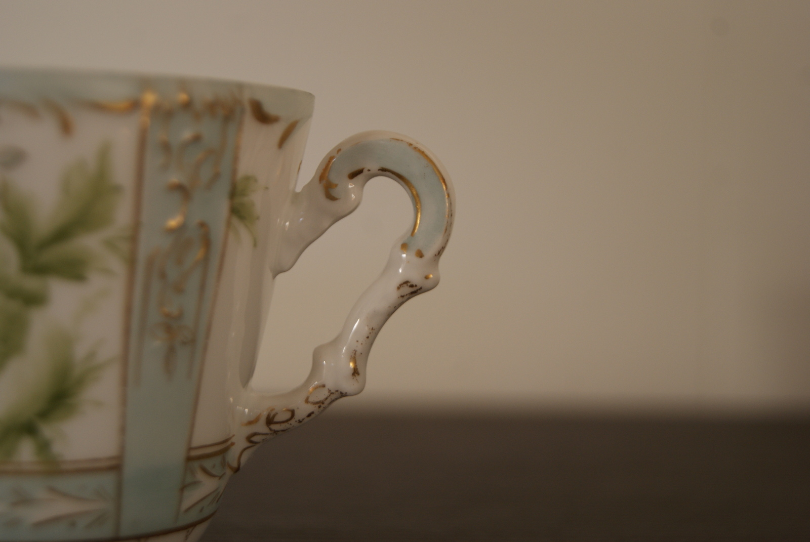 Niedersaltzbrunn Hermann Ohme cup with saucer and plate, handpainted green flowers and leaves, blue color, golden decor