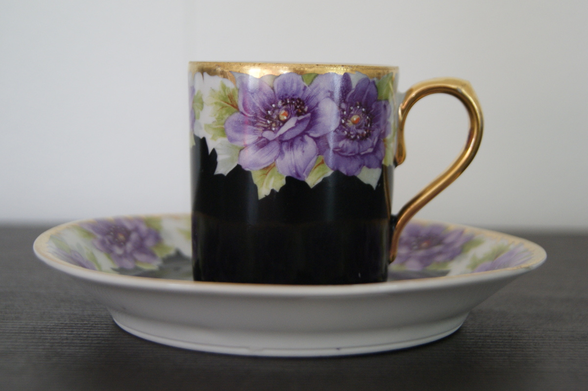 Waldenburg – Altwasser cup with saucer with blue flowers and black background